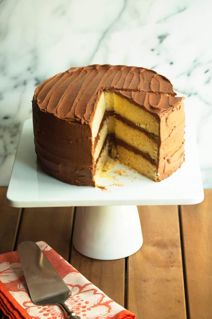 Classic Yellow Cake Recipe with Chocolate Frosting.  This yellow cake is a gem, so moist and buttery, and the chocolate frosting is whipped to perfection!