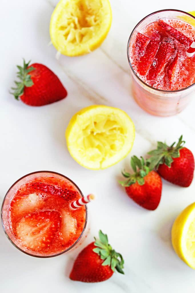 A perfectly tart, sweet, homemade and Easy Strawberry Lemonade Recipe that will make you want to drink from scratch lemonade from now on!