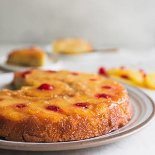Pineapple Upside Down Cake Recipe -  This is the best pineapple cake recipe online! It's a moist sponge cake caramelized to perfection with brown sugar pineapple rings and cherries. #pineapple #cherries #upsidedown #upsidedowncake #cake