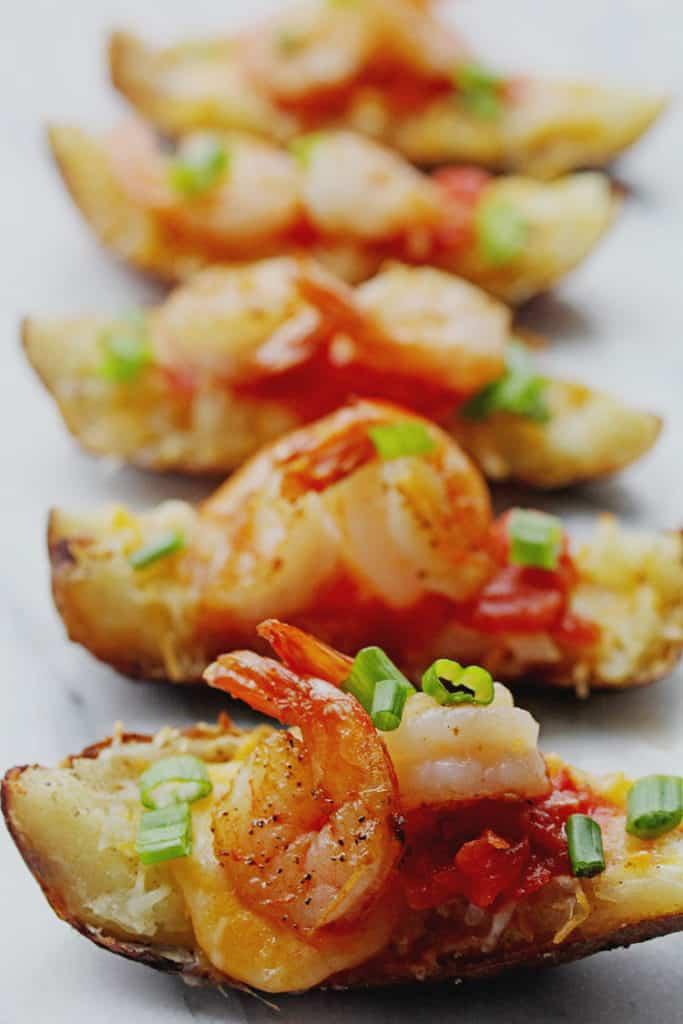 A row of shrimp nacho potato skins. You'll never eat a better potato skins recipe.