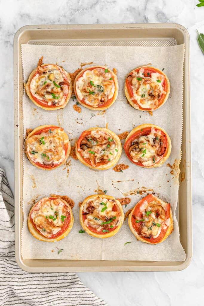 Oscar Tomato Tarts 1 683x1024 - Delicious and Easy Mini Tomato Tart (Puff Pastry) Recipe- Perfect for Entertaining!