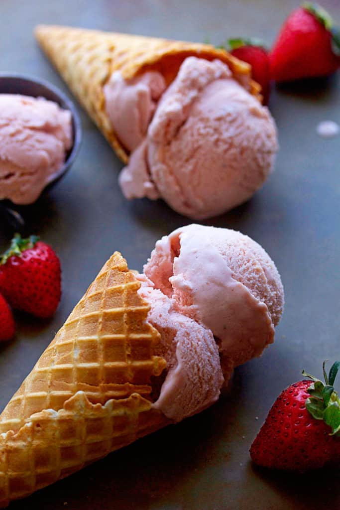 Sensational homemade strawberry ice cream enhanced with the richness of heavy cream and speckled with spring berries throughout.