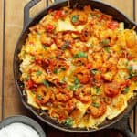 Blackened Shrimp Nachos in a large cast iron skillet ready to serve for super bowl