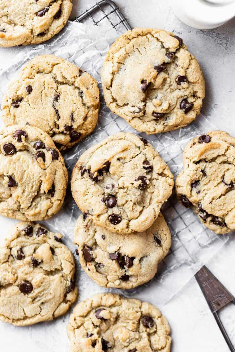 Overhead of several best chewy chocolate chip cookies against wire rack and white background