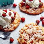 Strawberry Shortcake Funnel Cakes: Classic summer fair funnel cakes get a fun seasonal twist with a strawberry shortcake flavor! And watch the how to video!
