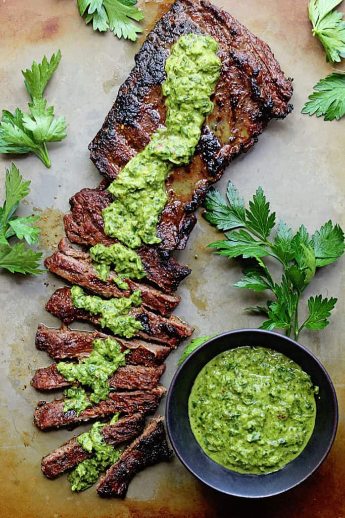 Skirt Steak Marinade with Chimichurri Recipe - No summer grill is complete without my skirt or flank steak marinade!  Easy, Absolutely delicious and beyond flavorful!