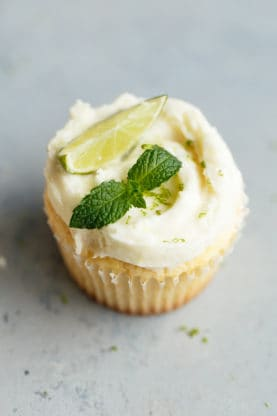 Lemon Cupcakes Recipe with Mojito Frosting  Perfectly tender, moist and zesty lemon cupcakes get topped with the smoothest and most delicious mojito flavored buttercream.