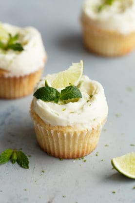 Fluffy Lemon Cupcakes Recipe with Mojito Frosting  Perfectly tender, moist and zesty lemon cupcakes get topped with the smoothest and most delicious mojito flavored buttercream.