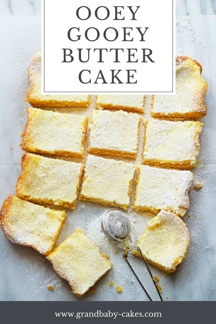 Ooey Gooey Butter Cake Recipe- This authentic gooey butter cake has a perfect chewy blondie texture bottom topped with a custardy cream cheese layer of perfection.This is the true original St. Louis classic. #cake
