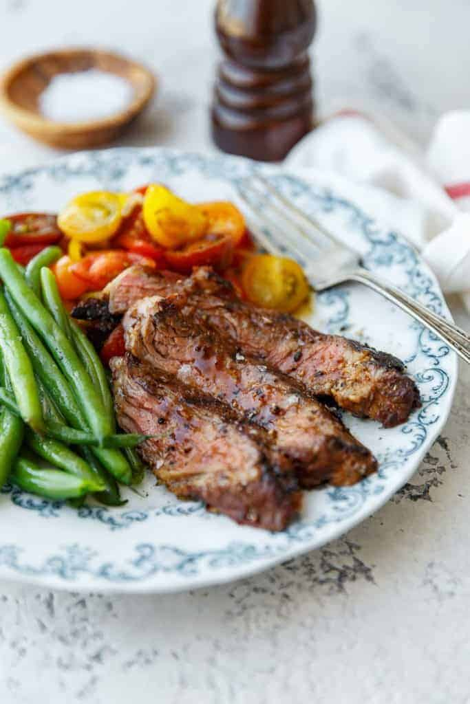 Grilled Ribeye Steak Recipe with Tequila Barbecue Glaze - Easily learn how to grill ribeye steak made perfectly tender and flavorful with a sweet yet tangy ribeye marinade.