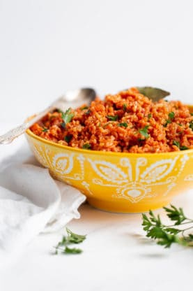 Jollof Rice Recipe inspired by my AncestryDNA Results - This is a true West African classic.  Fragrant rice is steeped in rich ingredients like meat stock, garlic, onions, tomatoes, and spicy chilies adding an incredible depth of flavor.