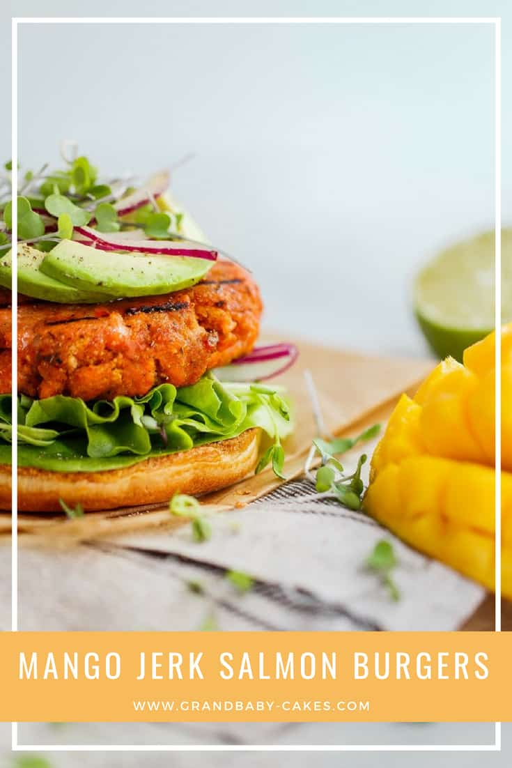 Mango Jerk Salmon Burgers- Do you know how to cook salmon burgers from scratch? This salmon burger recipe is surprisingly simple to make. These are filled with Jamaicanspice and jerk flavor along with the sweetness of fresh mango. So addictive! #burger #salmon #grill #jerk