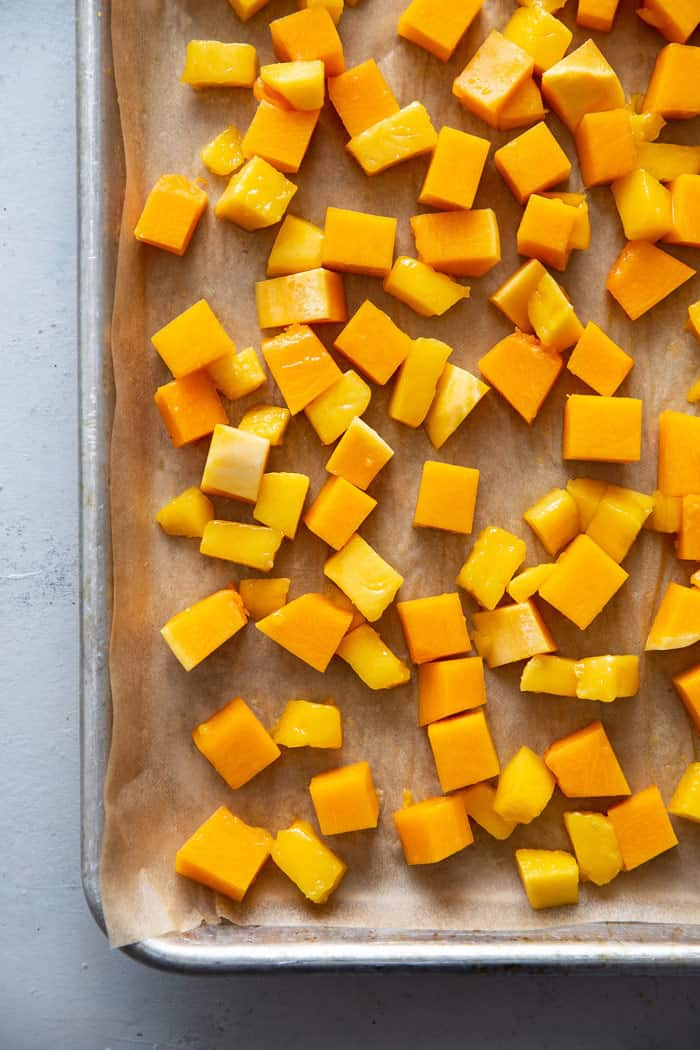 Baked Butternut Squash Cubes and mango ready to roast