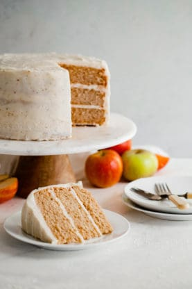 Spiced Cider Apple Cake Recipe with Brown Butter Frosting - A perfectly moist and tender fall cake flavored with apple cider and spices gets frosted with the most addictively creamy maple essenced brown butter frosting. Fall baking has never tasted so good!
