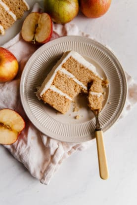 Spiced Apple Cider Cake Recipe with Brown Butter Frosting - A perfectly moist and tender fall cake flavored with apple cider and spices gets frosted with the most addictively creamy maple essenced brown butter frosting. Fall baking has never tasted so good!