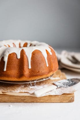 Sweet Potato Coffee Cake - A perfectly tender and moist sweet potato pound cake is highlighted by a ribbon of cinnamon spiced swirl and topped with an addictive maple glaze.