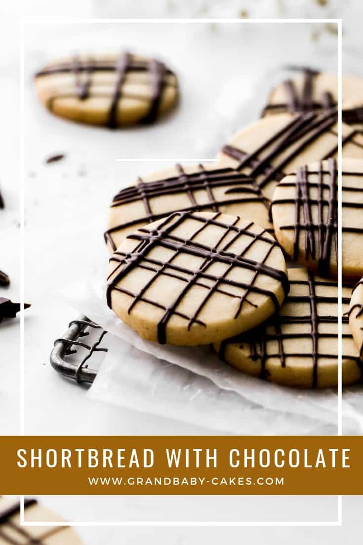 Perfect Shortbread Cookie Recipe with Chocolate - This recipe for shortbread cookies is irresistible!The initial bite is wonderfully crisp followed by a wonderful melt in your mouth buttery texture. The light drizzle of chocolate on top adds an added depth of flavor that is unforgettable! #cookies #chocolate #shortbread