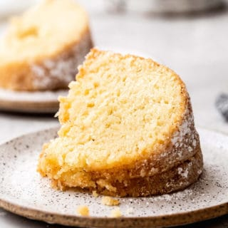 Close up of two slices of Kentucky Butter Cake on white plates