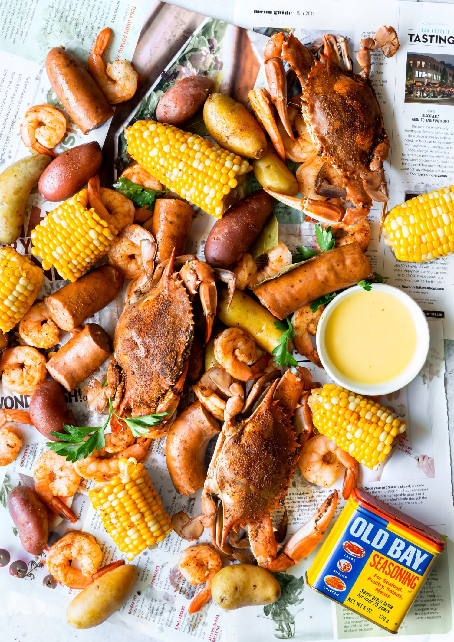 A overhead shot of full frogmore stew with blue crabs, shrimp, sausage, corn and potatoes with old bay seasoning- low country boil