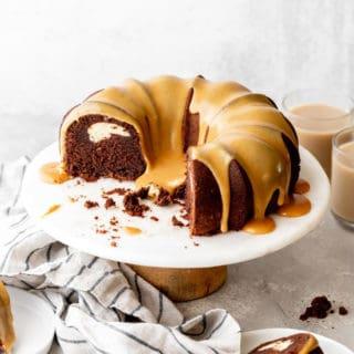 Beautiful chocolate bundt cake with white chocolate ganache glaze