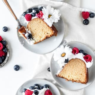 Slices of butter pound cake on white plates ready to serve