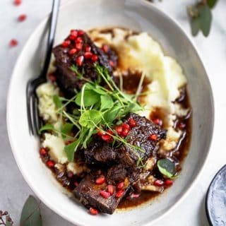 best braised short ribs over mashed potatoes ready to serve for the holidays