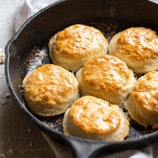 Delicious 7 up biscuits brushed in butter in a cast iron skillet ready to serve