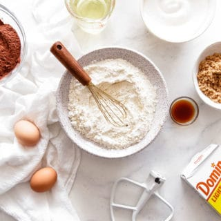 Baking Substitutions ingredients like flour, sugar and eggs scattered around
