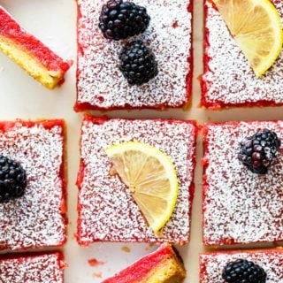 Blackberry lemon bars overhead with lemon bars and blackberries ready to serve