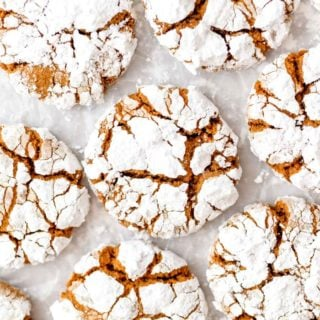 Gingerbread cookies on a white background with powdered sugar on top