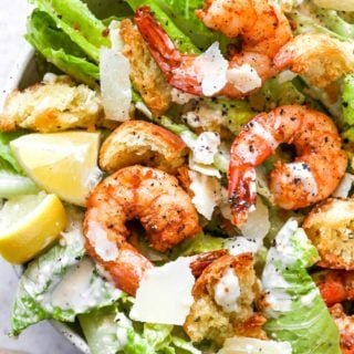 Creole shrimp on a bed of lettuce with caesar dressing