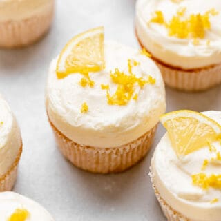 A gathering of cupcakes with lemon flavor ready to be eaten