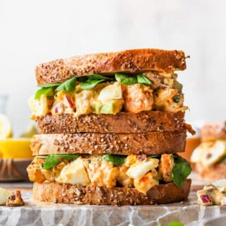 Two egg salad sandwiches stacked on top of one another
