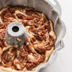 Cake batter swirled in a bundt pan after using homemade cake release