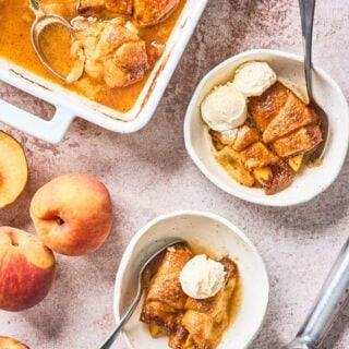 Peach dumplings on plates ready to enjoy with vanilla ice cream on top