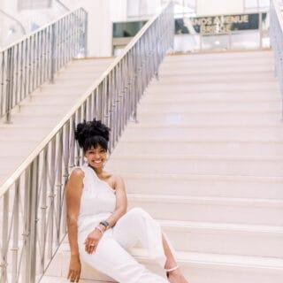 Jocelyn Delk Adams sitting on steps at The Palazzo