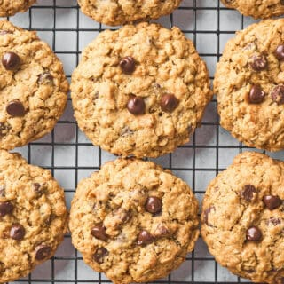 Baked oatmeal chocolate chip cookies on a wire rack